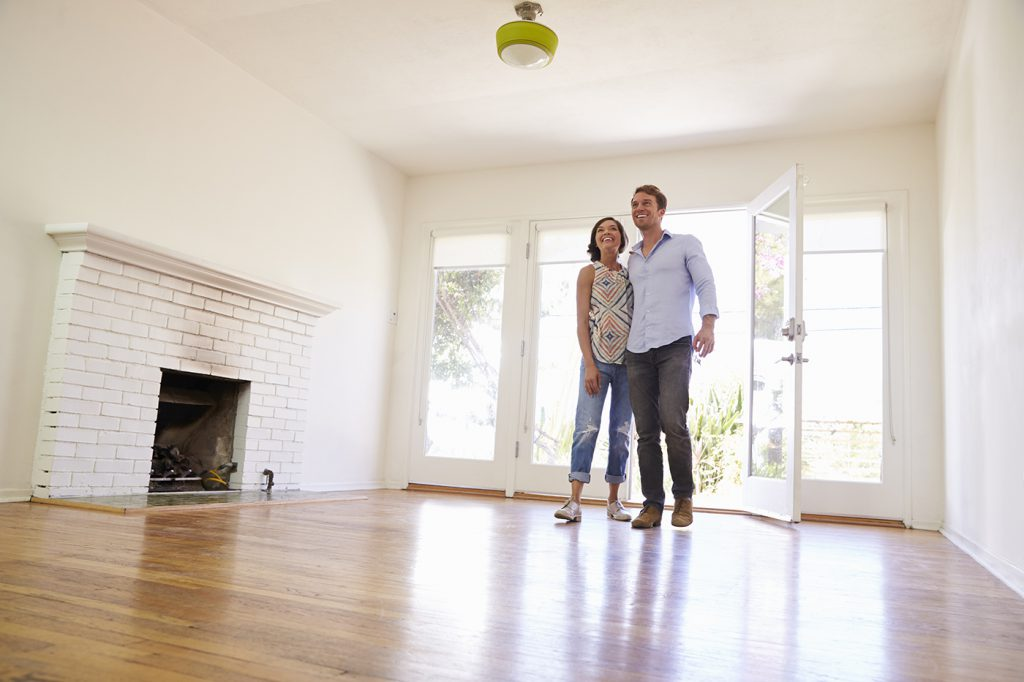Excited Couple Explore New Home On Moving Day